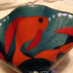 Detail showing fish from outside of bowl.
